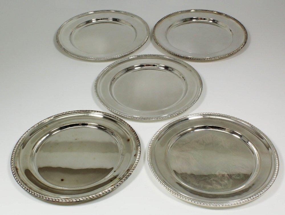 Six Elizabeth II silver circular plates with gadroon mo