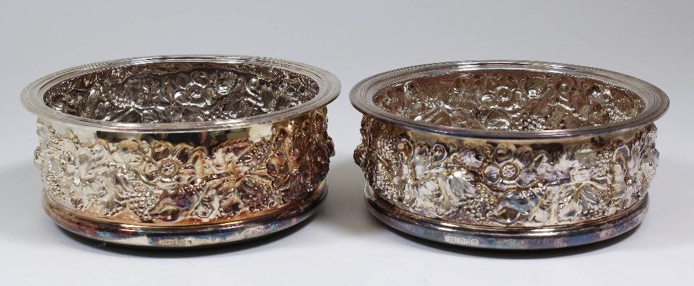 A pair of Elizabeth II silver circular coasters cast wi