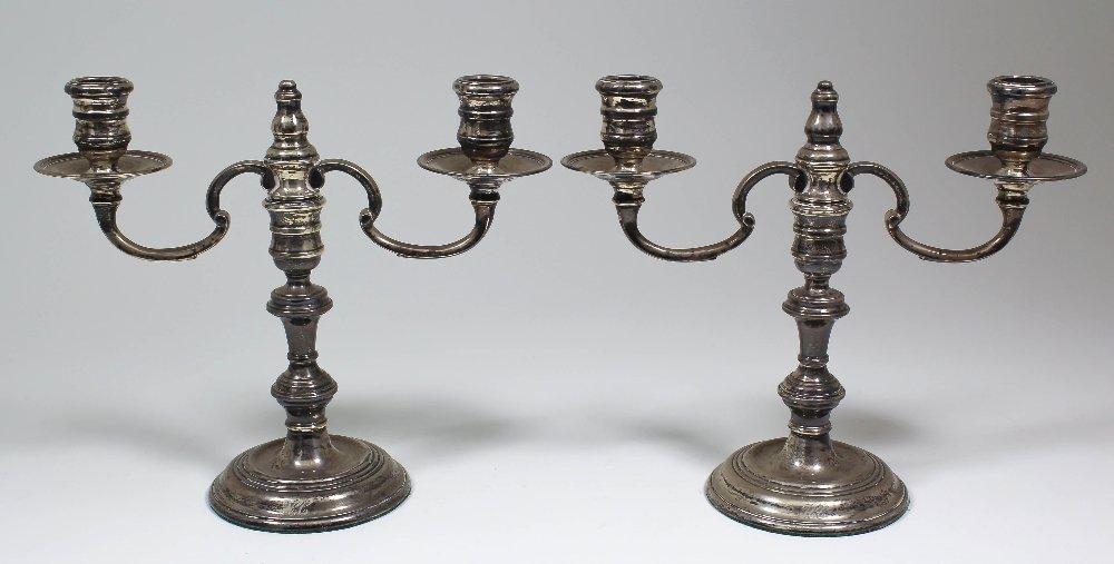 A pair of Elizabeth II silver two light candelabra each