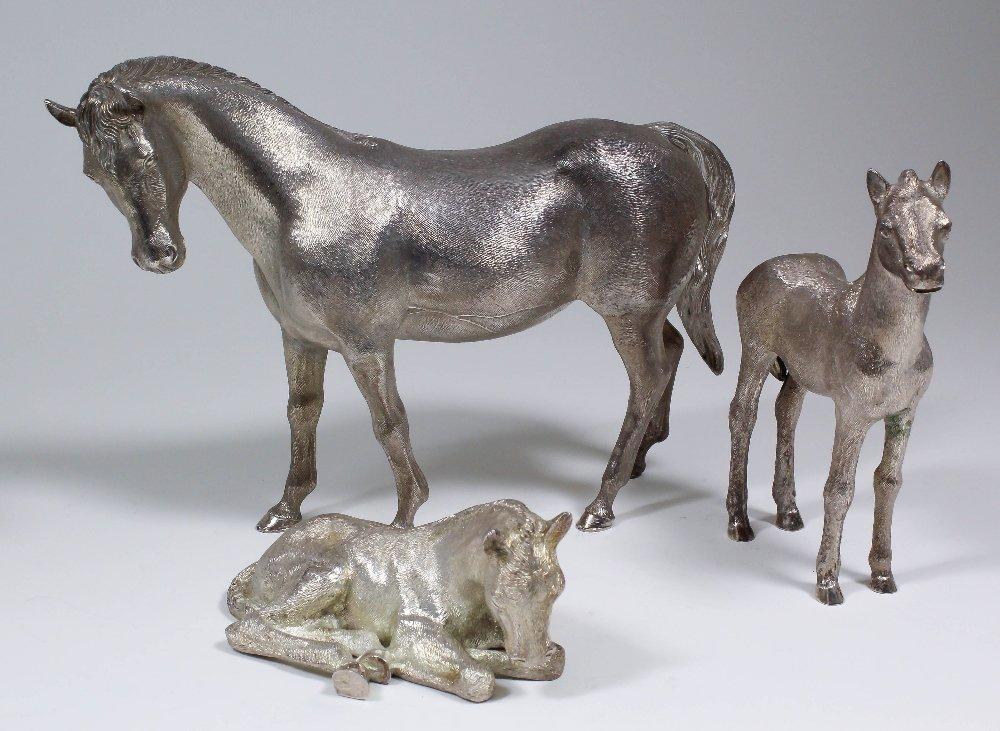 A group of three Elizabeth II cast silver models by C.J