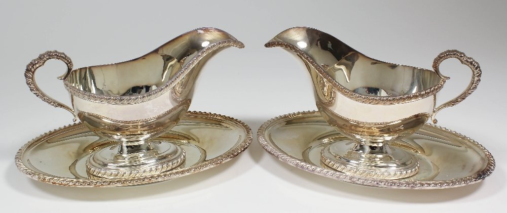 A pair of Elizabeth II silver oval sauce boats and stan