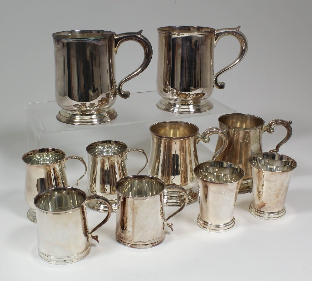A pair of Elizabeth II silver pint tankards with S-scro