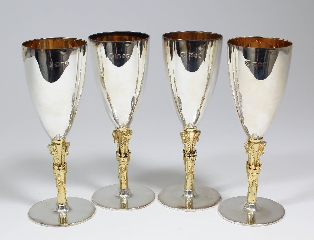 A set of four Elizabeth II silver and silver gilt wine