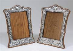 A matched pair of Edward VII silver rectangular photogr