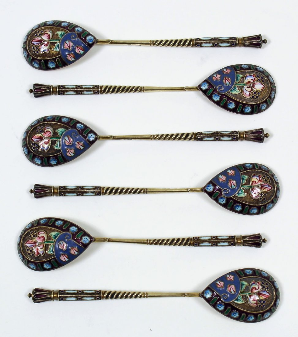 A set of six Russian silvery metal and champleve enamel