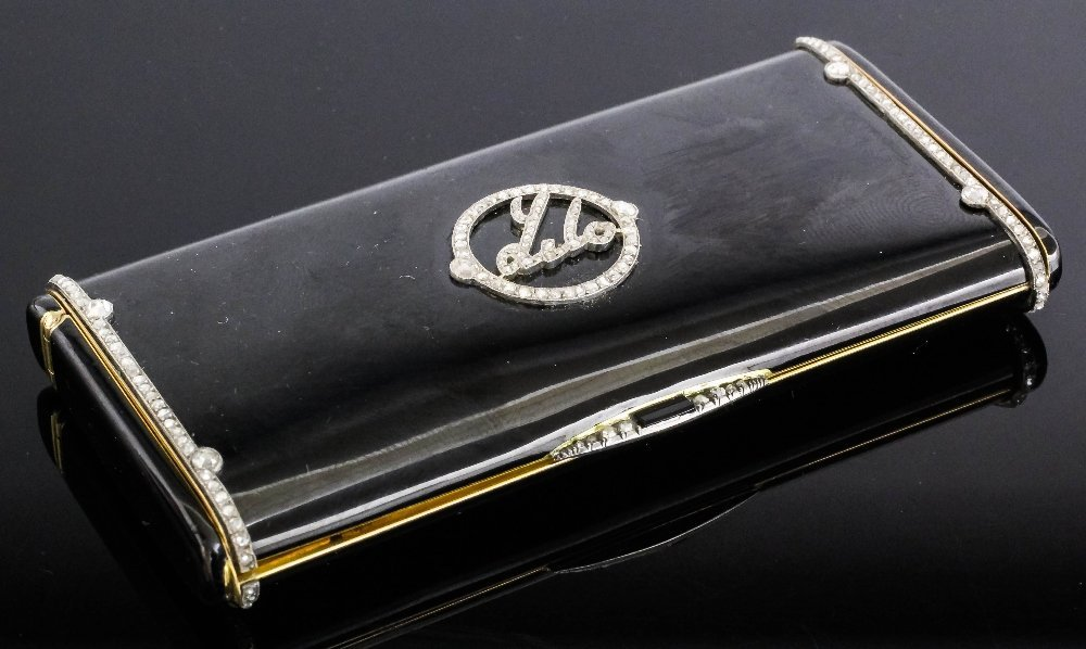 An 1920's Cartier gold coloured metal, black enamel and