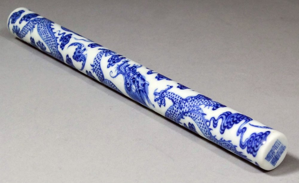 A Chinese blue and white porcelain brush handle painted