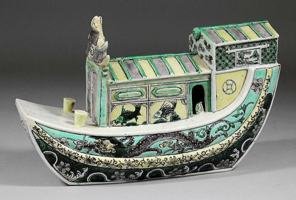 "A Chinese ""Famille Verte"" porcelain model of a house bo"