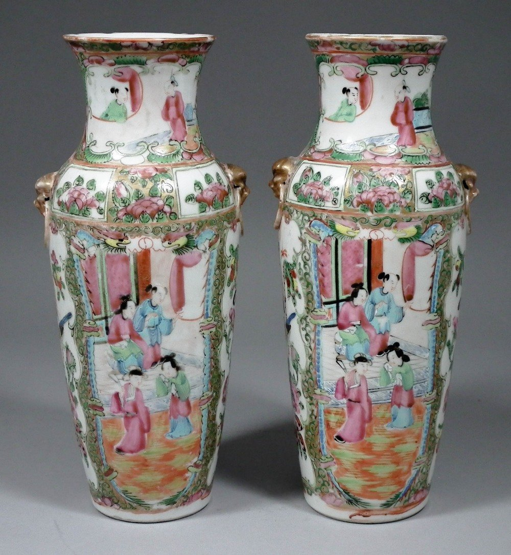 A pair of Chinese Cantonese porcelain two-handled vases