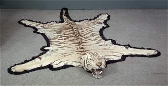 A 1920s tiger skin, the mounted head with glass eyes an