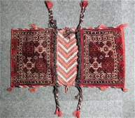 An antique Turkman saddle bag woven in black and ivory