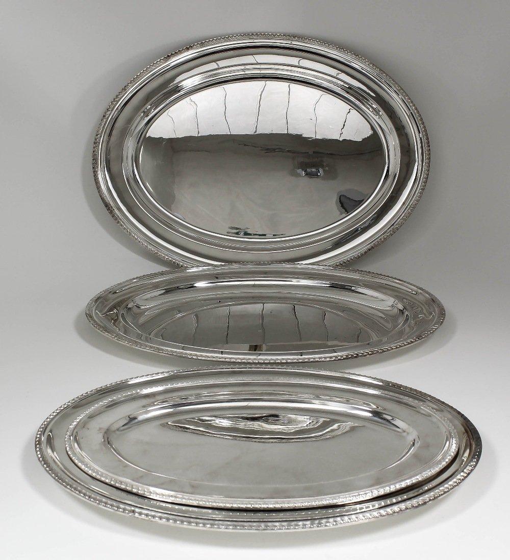 A set of four Elizabeth II silver oval meat plates of g