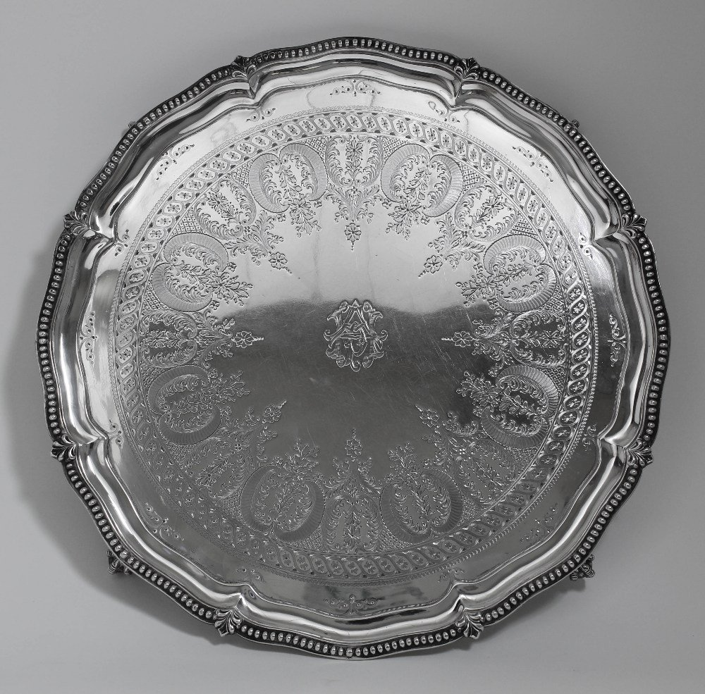 A Victorian silver circular salver, the shaped and moul