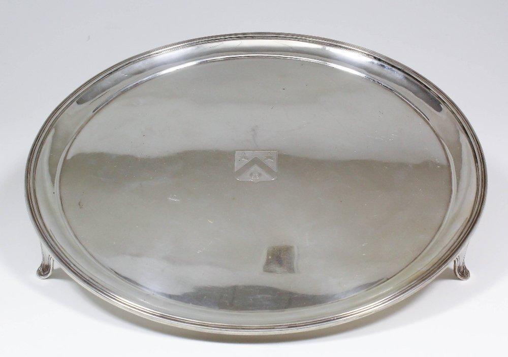 A George V silver circular salver of George III design