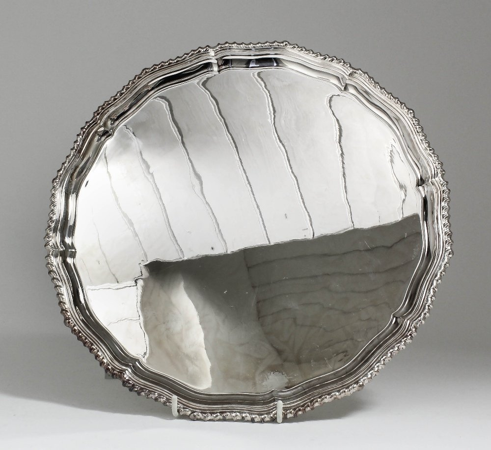 An Elizabeth II silver circular salver, the shaped and