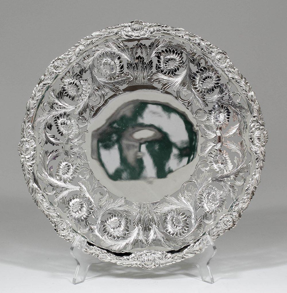 An Elizabeth II silver circular dish with leaf and flor