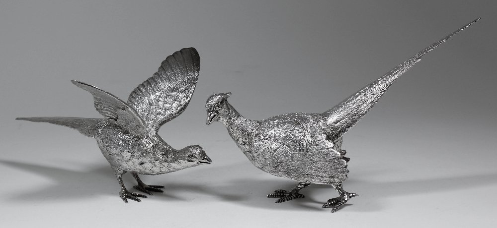 A pair of Elizabeth II cast silver figures - Peacock an