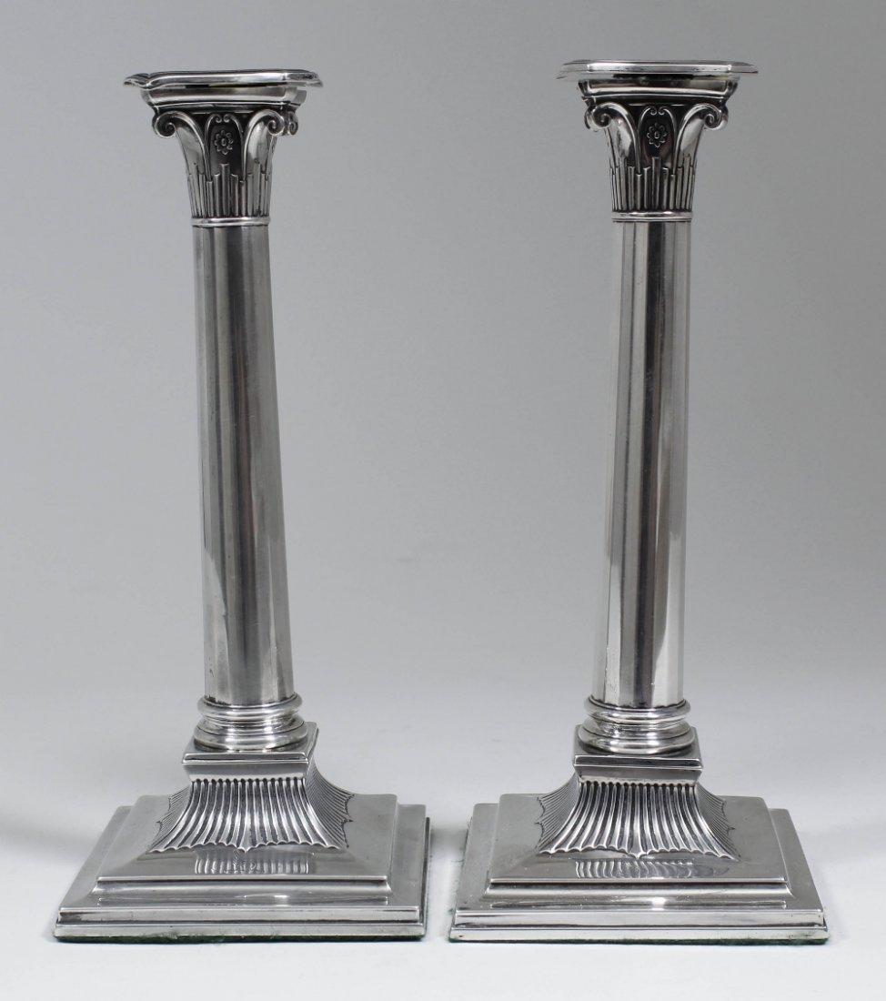 A pair of George III silver pillar candlesticks of colu