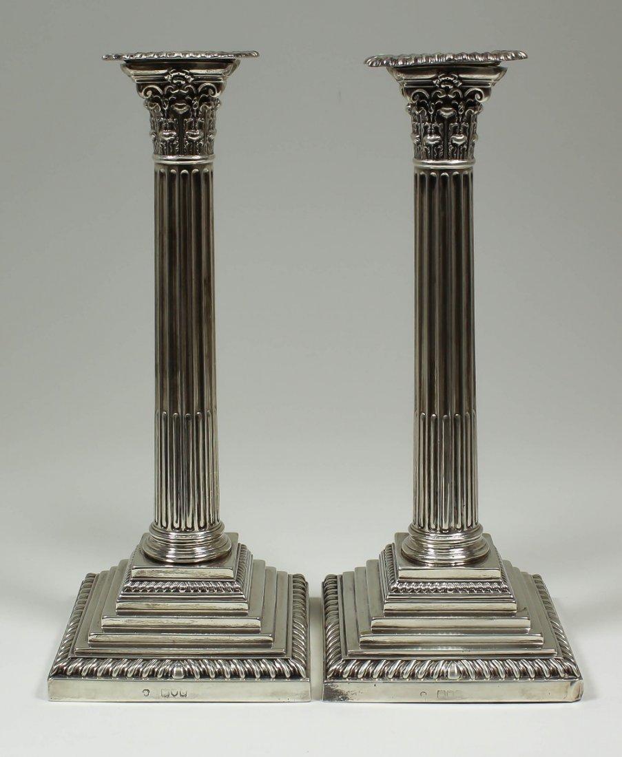 A pair of late Victorian silver pillar candlesticks, th