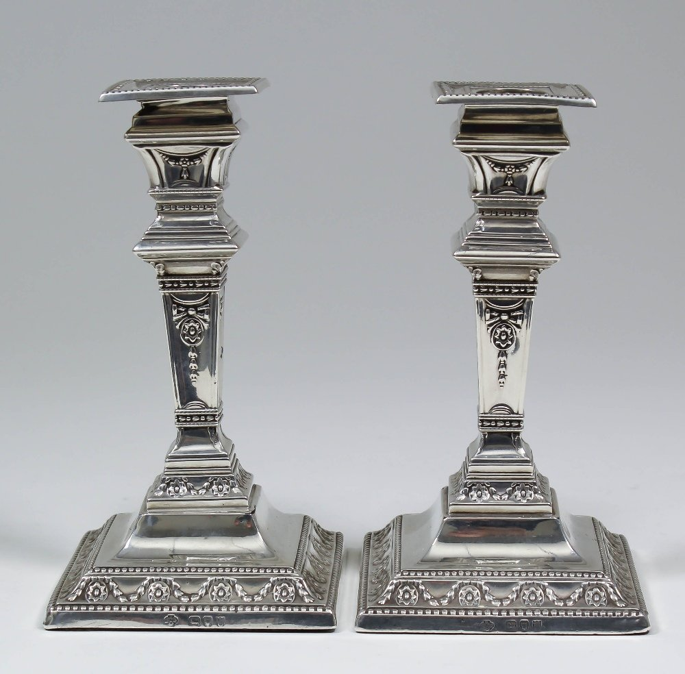 A pair of late Victorian silver square section pillar c