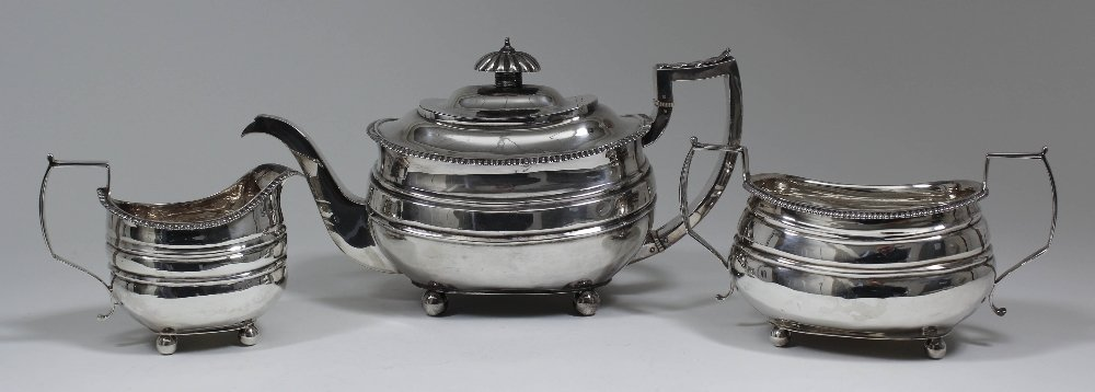 A George III silver rectangular three piece tea service