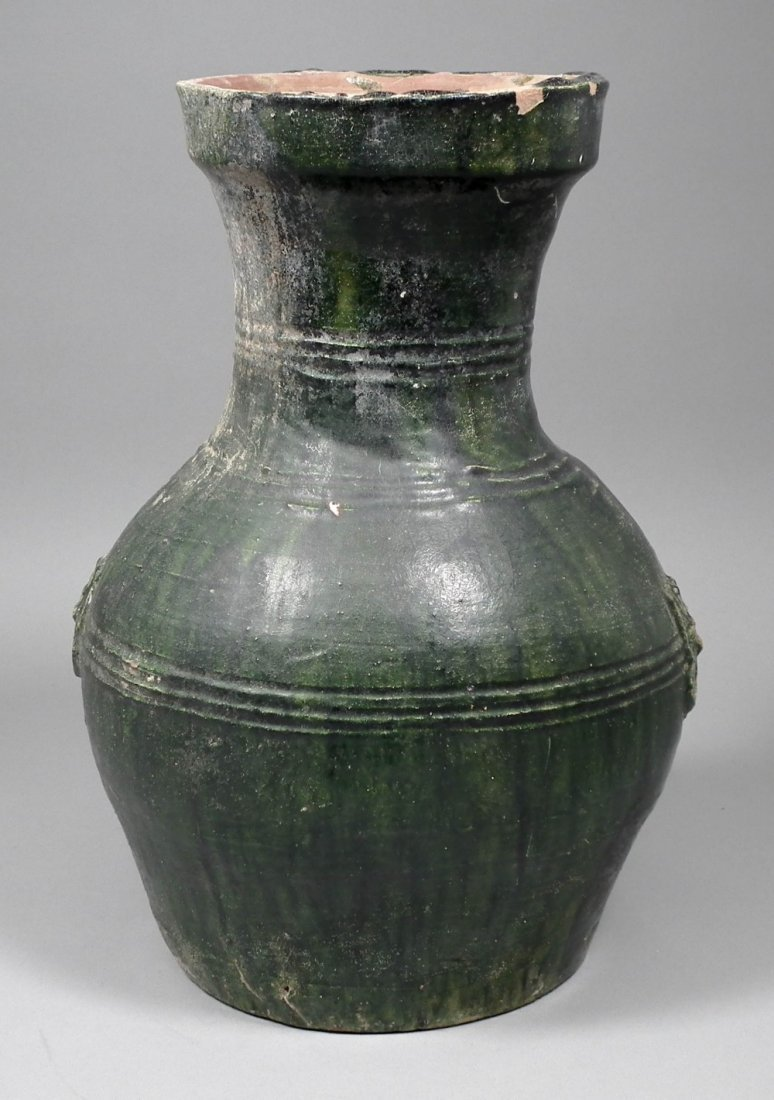 A Chinese green glazed bulbous vase with moulded handle