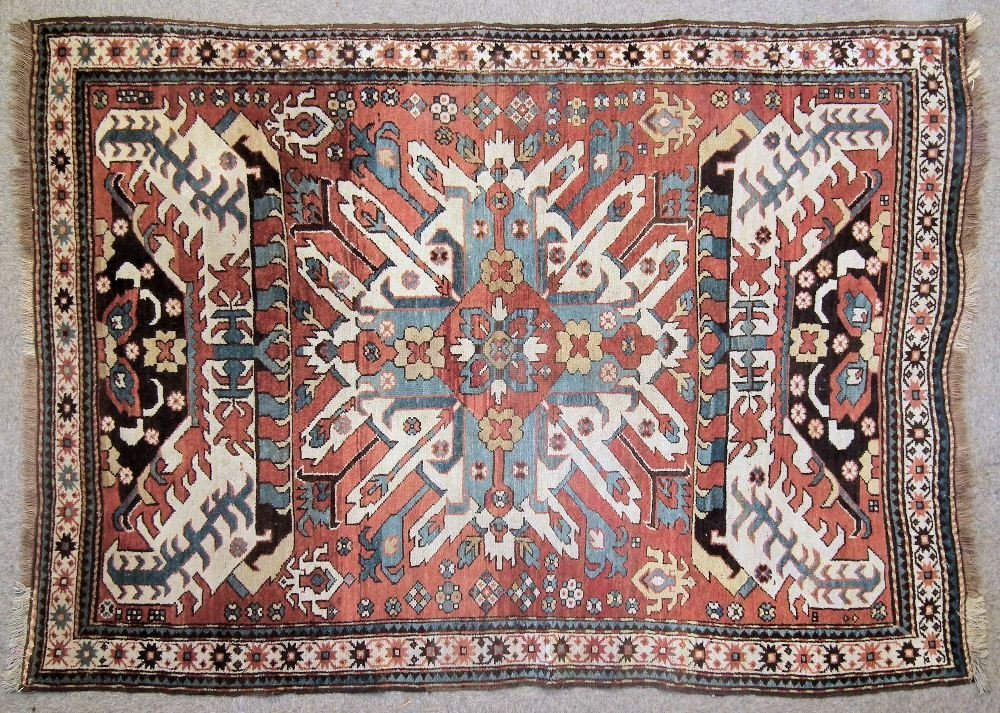 A Caucasian rug woven in primary colours with star shap
