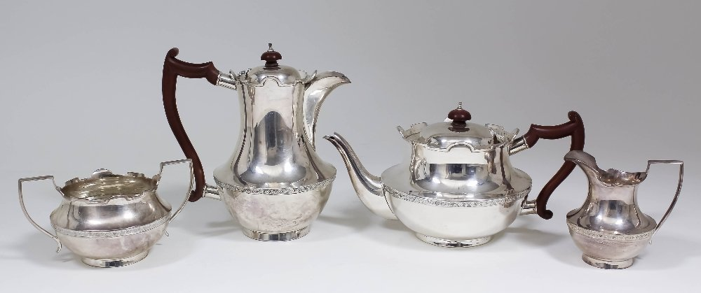 A George V silver four piece tea service, the squat