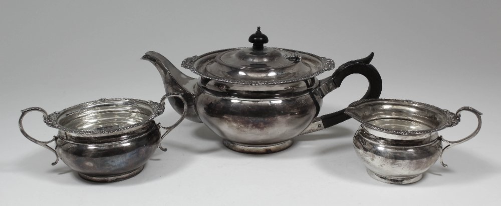 A George V silver circular three piece tea service with