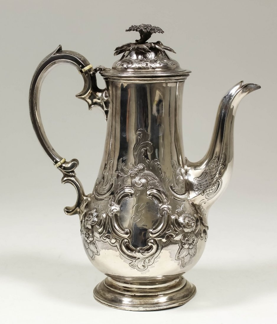 A Victorian silver baluster shaped coffee pot with cast