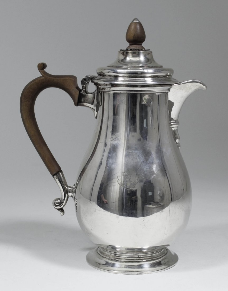 A Victorian silver baluster shaped hot water pot with