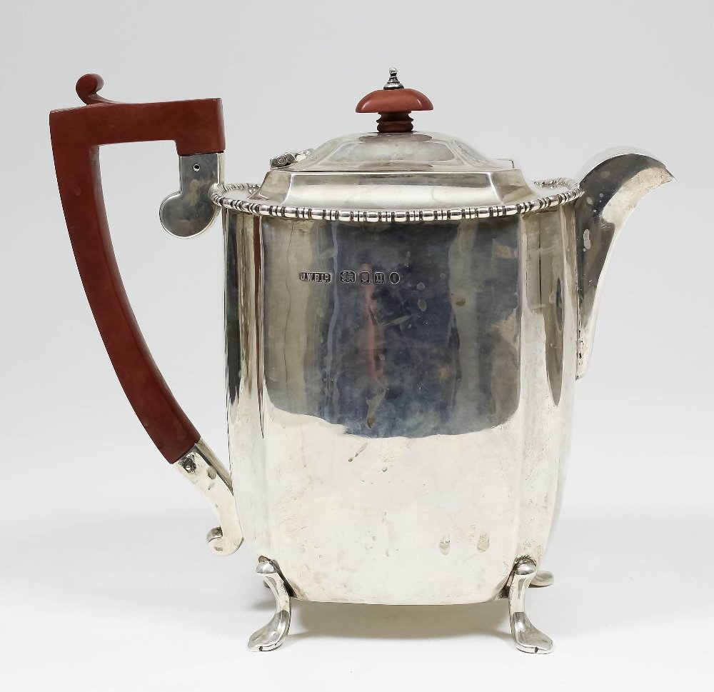 A George V silver hot water pot, the plain body with