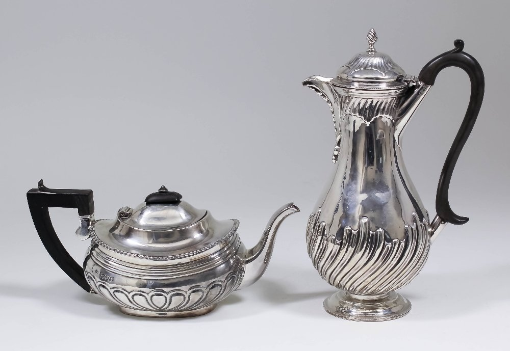 An Edward VII bachelor's silver oval teapot with squat