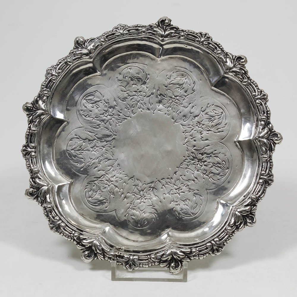 A George III silver circular waiter with shaped and