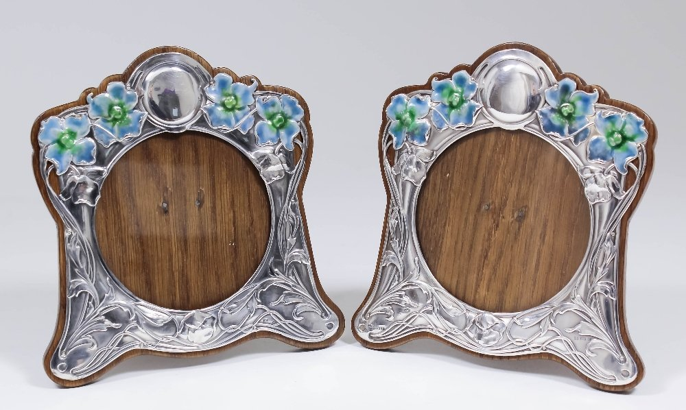 A matched pair of Edward VII silver and enamelled