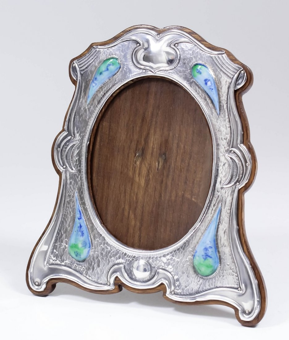 An Edward VII silver and enamelled photograph frame of