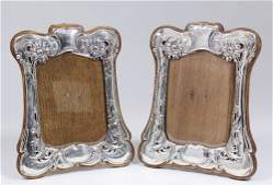 A matched pair of Edward VII silver photograph frames