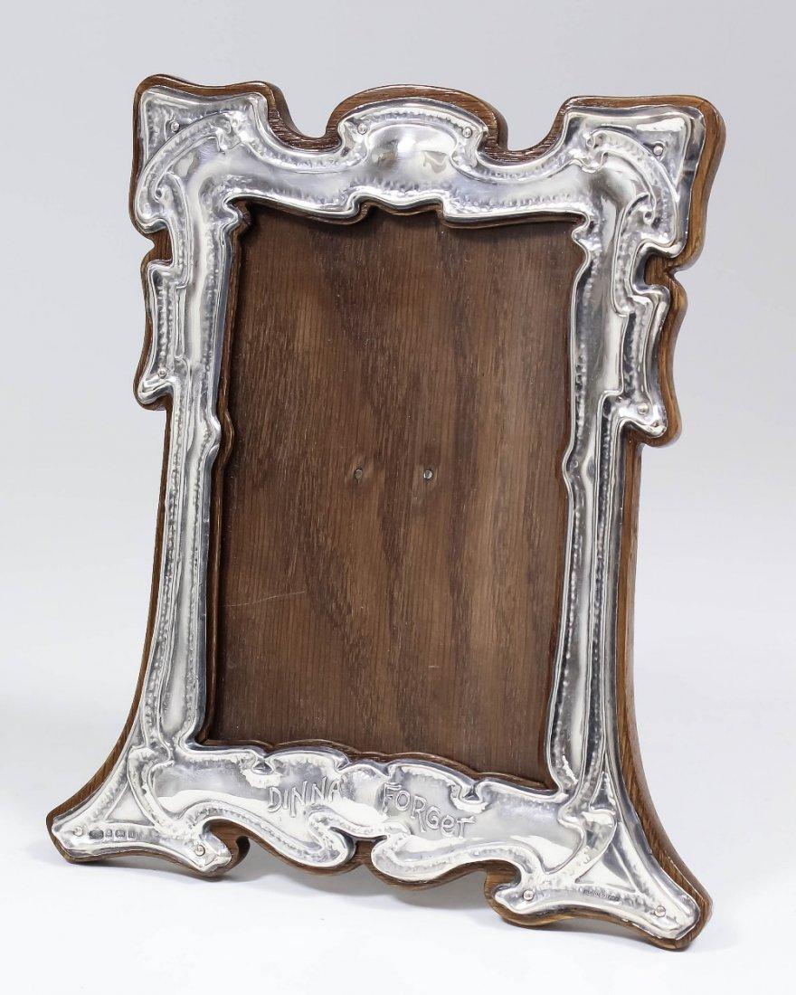An Edward VII silver rectangular photograph frame of