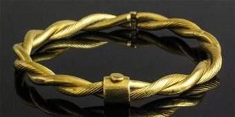 A modern 22ct gold rope twist pattern stiff bangle,