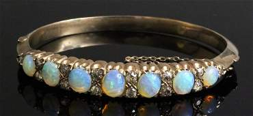 A late Victorian gold coloured metal mounted opal and