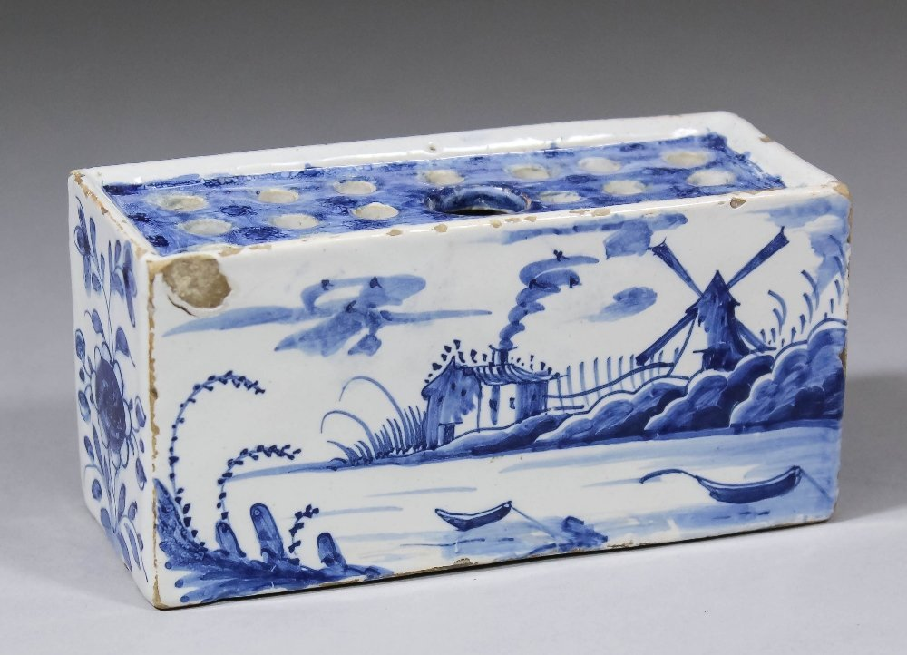 A mid 18th Century English Delft flower brick, the two