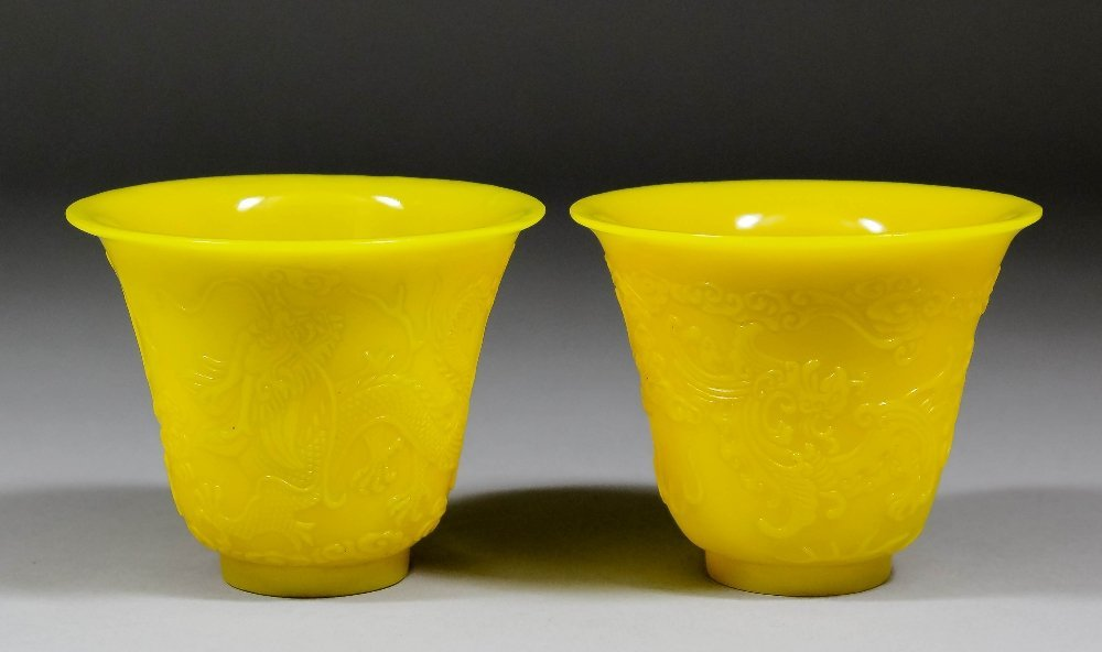 "A pair of yellow Peking glass ""Dragon and Phoenix"""
