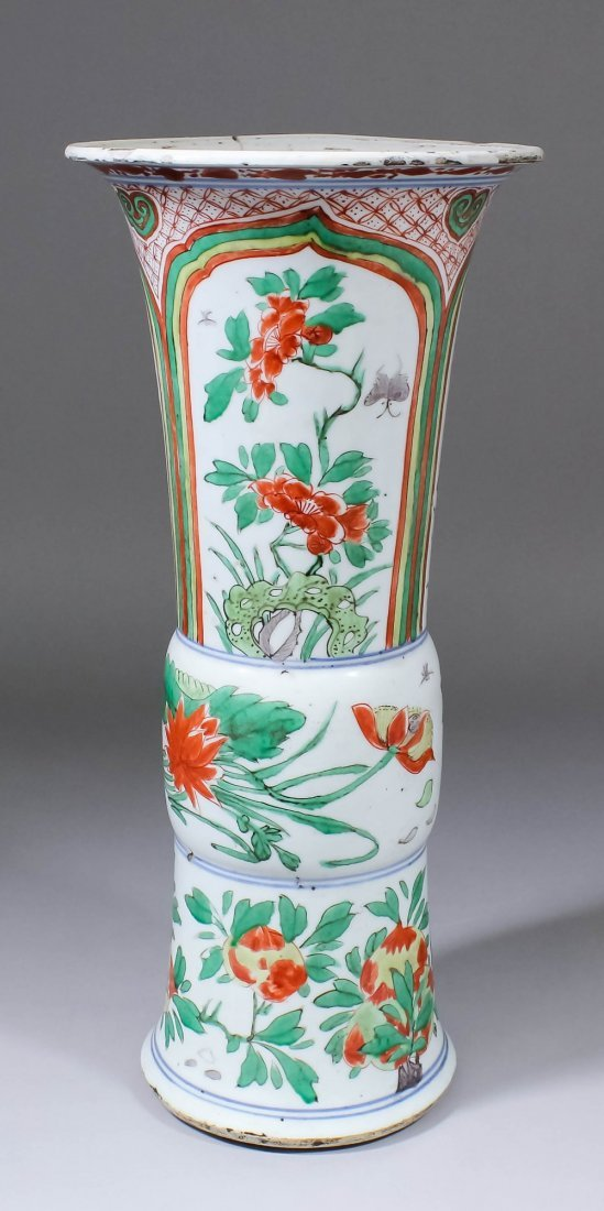 A Chinese porcelain flared vase painted in colours with