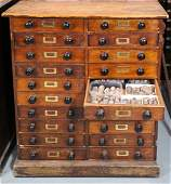 A Victorian stained pine collectors cabinet fitted