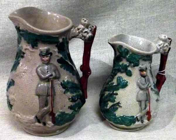 4: Two graduated 19th century Staffordshire jugs with m
