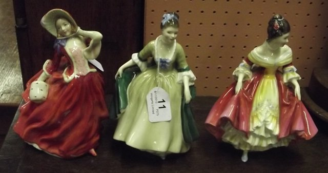 11: Three Royal Doulton figures, Autumn Breezes HN 1934