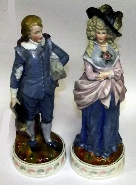 18: Pair of late 19th century porcelain figures of a yo