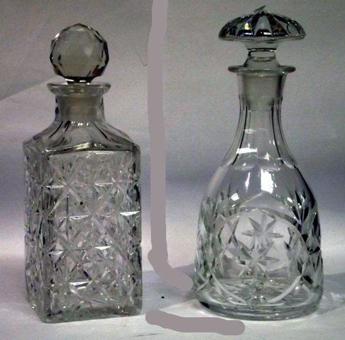 22: Square cut glass decanter with stopper and a circul