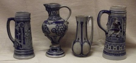 Four various German salt glazed jugs.