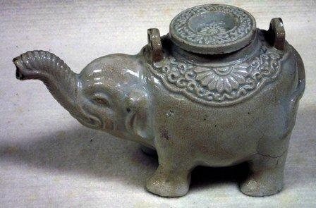 Oriental ceramic tea pot modelled as a standing elephan